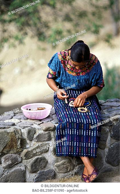 An art craftswoman in Panajachel on the shore of the Lago de Atitlan in Centrally Guatemala in Central America
