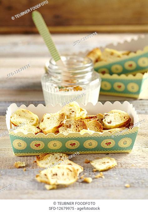 Bagel chips with a cream cheese dip in paper box