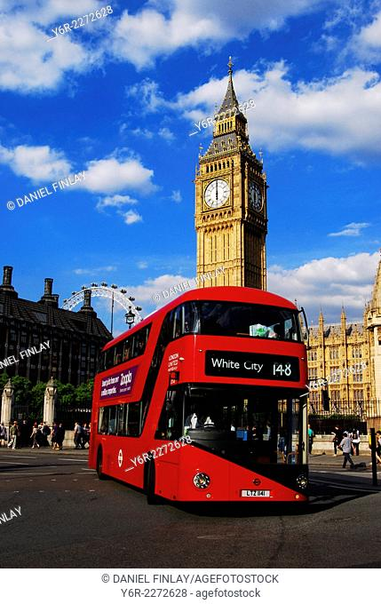 Red bus in Parliament Square on a sunny day in the heart of London, England
