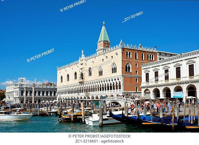View from the waterfront Riva degli Schiavoni with tourists at the Dogeâ. . s Palace and Campanile of Venice - Italy