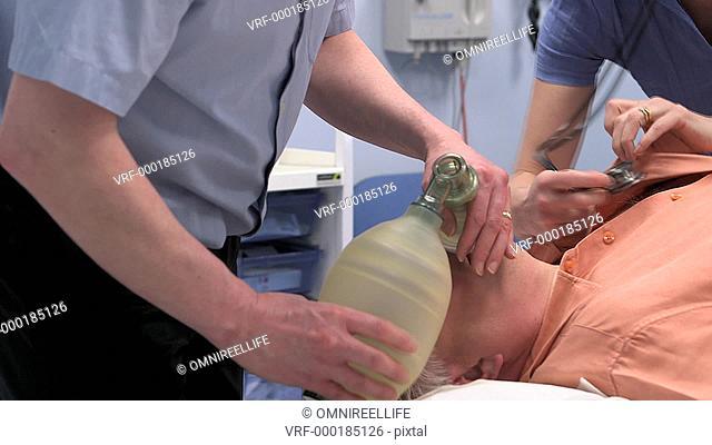 PAN Doctor and nurse resuscitating senior man