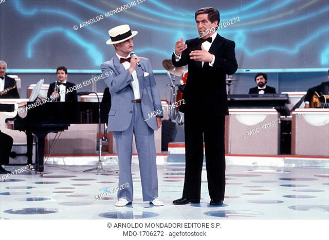 Corrado with a competitor in the TV show La Corrida. Italian television and radio presenter and writer Corrado (Corrado Mantoni) gesticulating next to a...