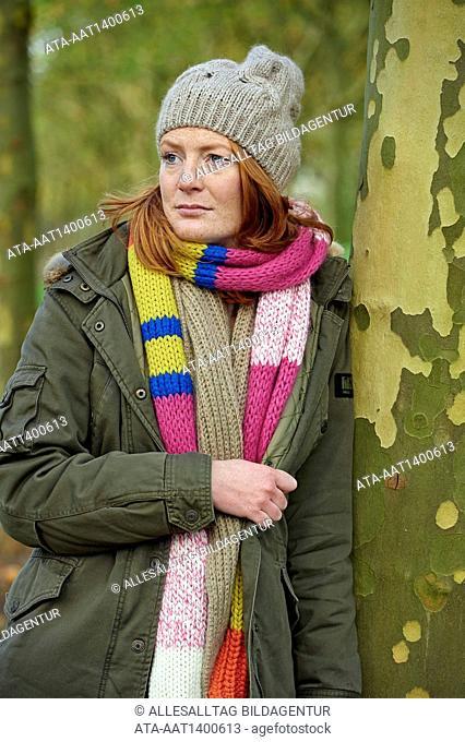 Pensive woman in autumn