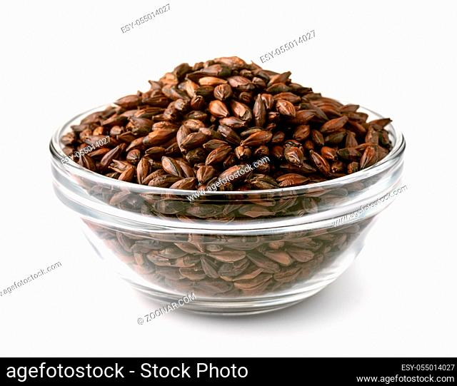 Glass bowel of dark malted barley isolated on white