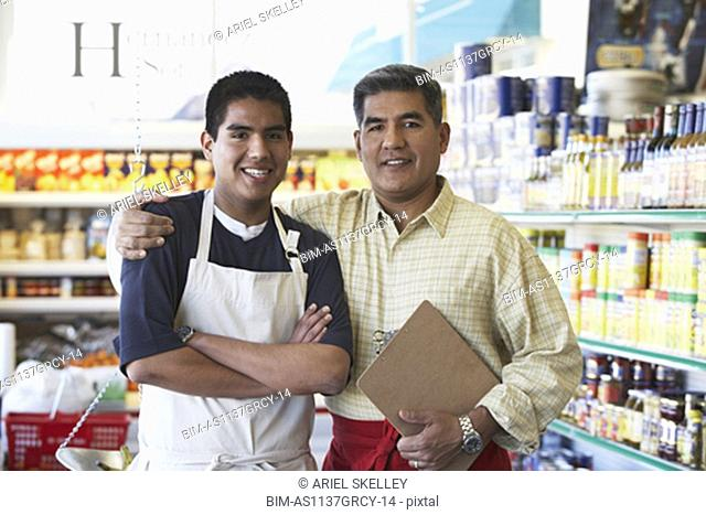 Hispanic father and son in family owned bodega