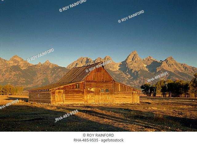 Historic barn and the Teton Range, Grand Tetons National Park, Wyoming, United States of America, North America