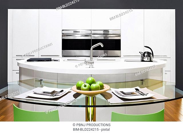 Table and countertops in modern kitchen