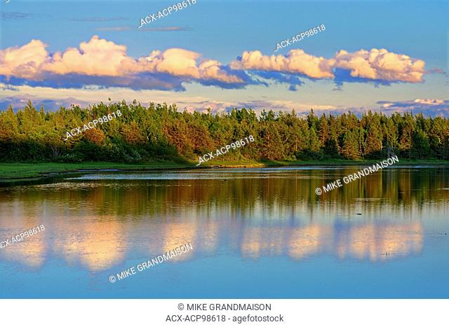 Clouds reflected in an inlet at sunset Richibucto New Brunswick Canada