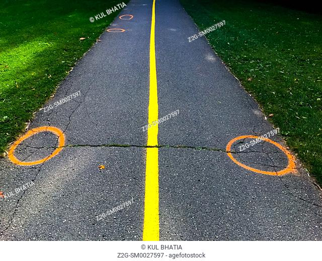 Two circles and a line, painted on a path, conceptual image depicting balance, equipoise, and equanimity