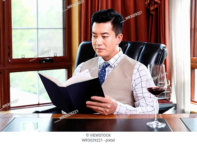 The business man reads in the study