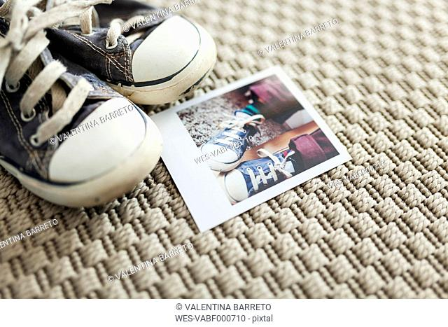 Polaroid of little boy's old shoes