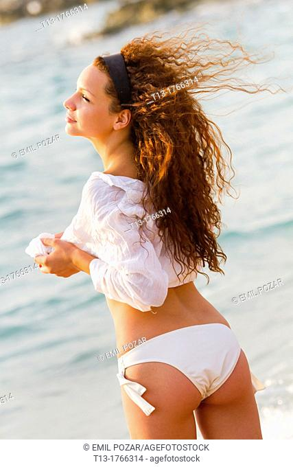Young woman on the beach in the morning