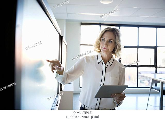 Businesswoman digital tablet using touch screen conference room