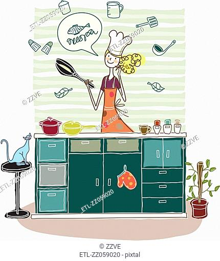 Woman holding frying pan in kitchen