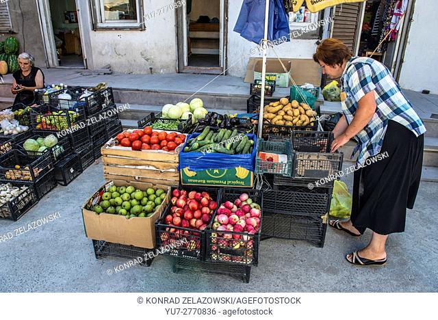 Woman selling fruits and vegetables on a green market in Borjomi resort town, Samtskhe-Javakheti region in Georgia