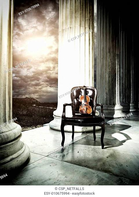 Old chair and violin
