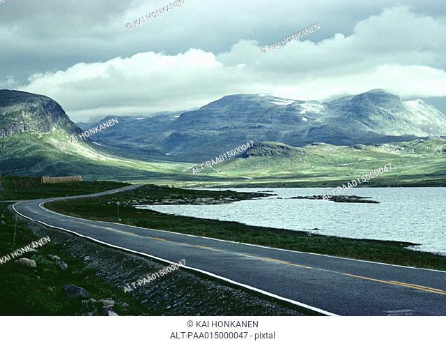 Sweden, road next to sea and mountains