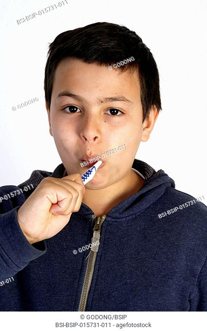 12-year-old boy brushing his teeth