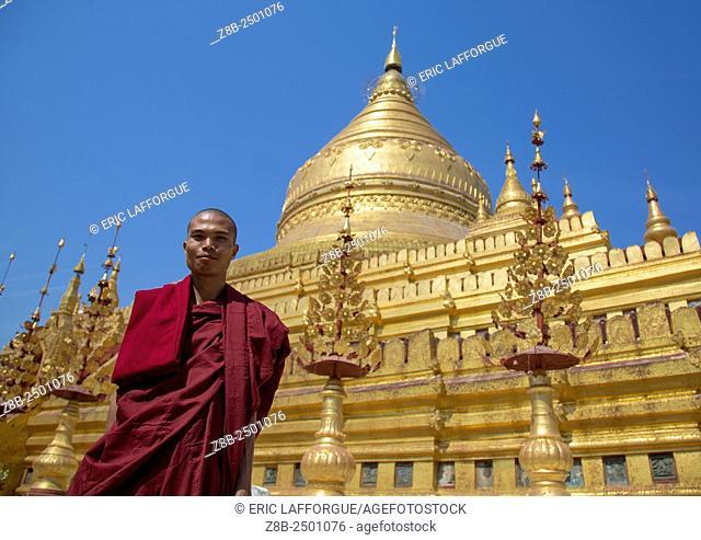 Monk In Front Of Shwe Zigon Paya Golden Temple, Bagab, Myanmar