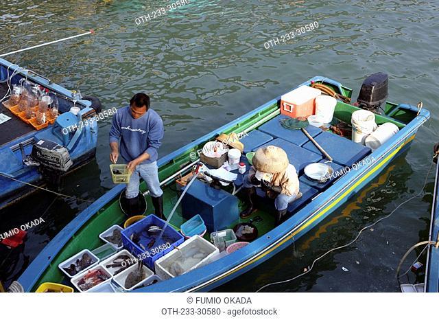 Fishermen selling seafood at the pier, Sai Kung, Hong Kong