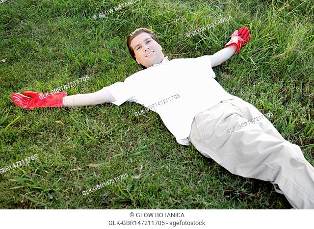 Man lying on grass and smiling