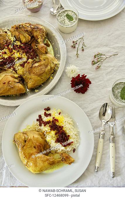 Zereshk Polo ba Morgh (saffron-braised chicken legs on barberry rice, Persia)