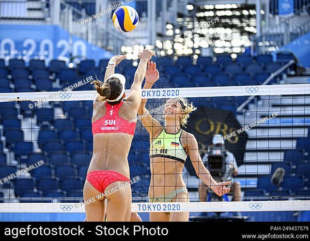 Laura LUDWIG (GER) action on the net versus Tanja HUBERLI (Hueberli, HÃ-berli) (SUI), beach volleyball women, preliminary round, Tanja HUBERLI (Hueberli