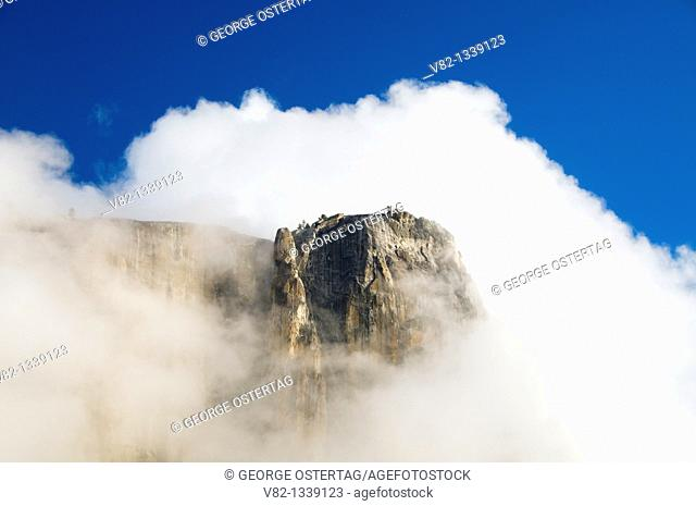 Cliff in clouds from Yosemite Falls Trail, Yosemite National Park, California