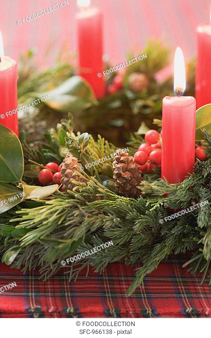 Advent wreath with four burning candles