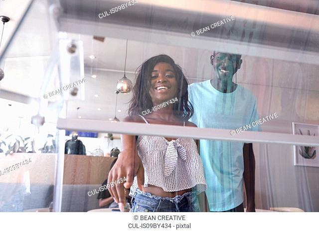 Couple choosing ice cream in parlour