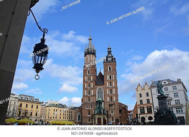 Saint Mary's Church and Polish poet Adam Mickiewicz monument from the Cloth Hall in the Rynek Glowny -Main Square-. Krakov, Poland, Europe