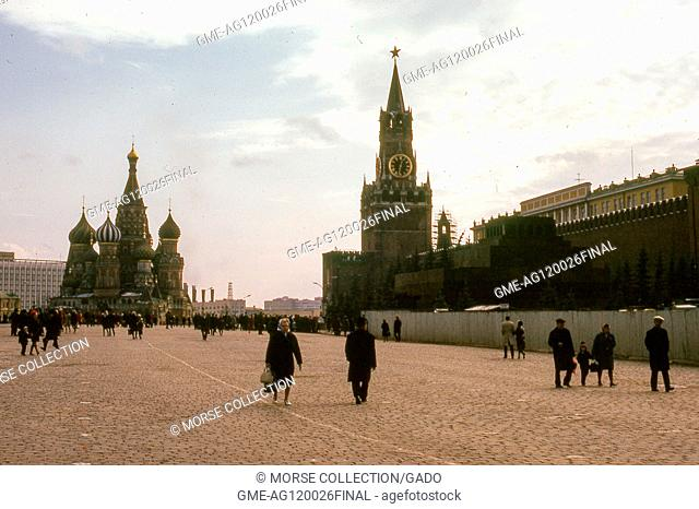 Panoramic view facing south of Red Square, Moscow, Soviet Russia, USSR, November, 1973. Visitors crisscross the plaza between Saint Basil's Cathedral at left...