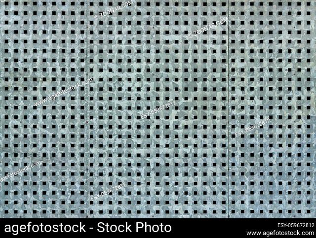 Metallic background with perforation of square holes