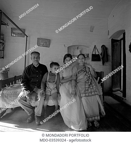 Portrait of an Indian family posing in front of goal. Varanasi, India, 1965