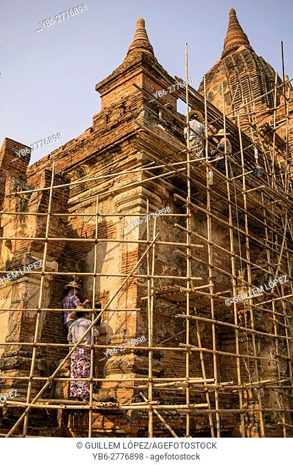 Women working on a undergoing renovation of an ancient temple in Bagan, Myanmar