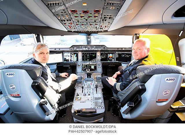 Pilots Jari Paajanen (l) and Pertiv Vartola sitting in the cockpit of a Finnair Airbus A350 XWB at the airport in Hamburg, Germany, 11 October 2015