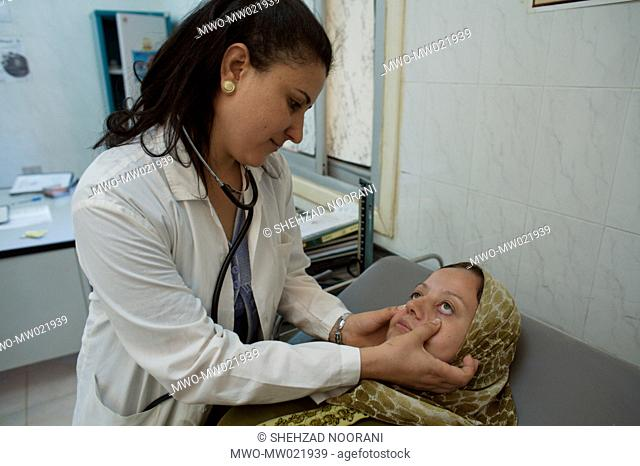 A doctor conducts a physical checkup of 21 years old Sana Kamel Ali, at the Karamta Family Health Unit in the village of Karamta
