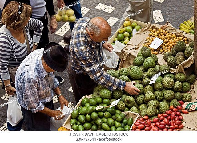 Buyers and sellers in the vegetable market in Santa Luzia, Funchal, Ilha da Madeira, Portugal
