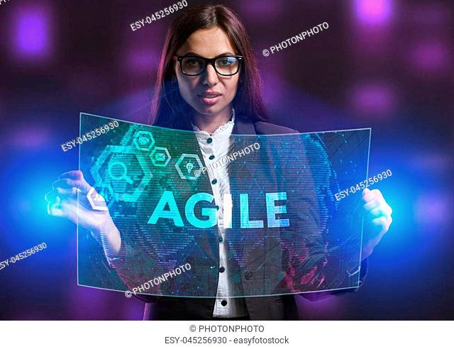 The concept of business, technology, the Internet and the network. A young entrepreneur working on a virtual screen of the future and sees the inscription:...