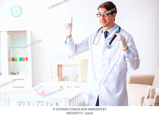 Doctor preparing for baby vaccination