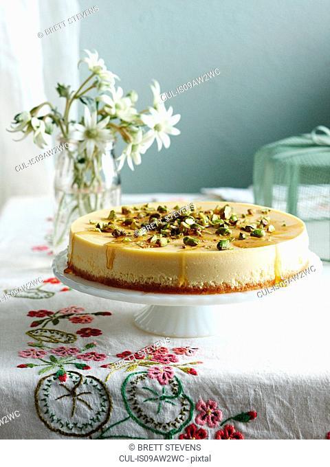 Ricotta honey cheesecake on cake stand