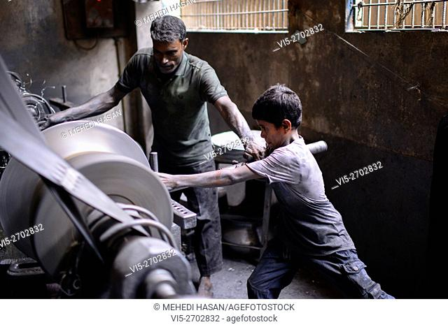 Child Worker Working In A Silver Cooking Pot Factory It Is Common