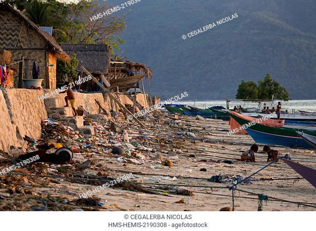 Indonesia, Lesser Sunda Islands, Alor archipelago, Pantar Island, Kabir, children defecating on the beach covered of garbage