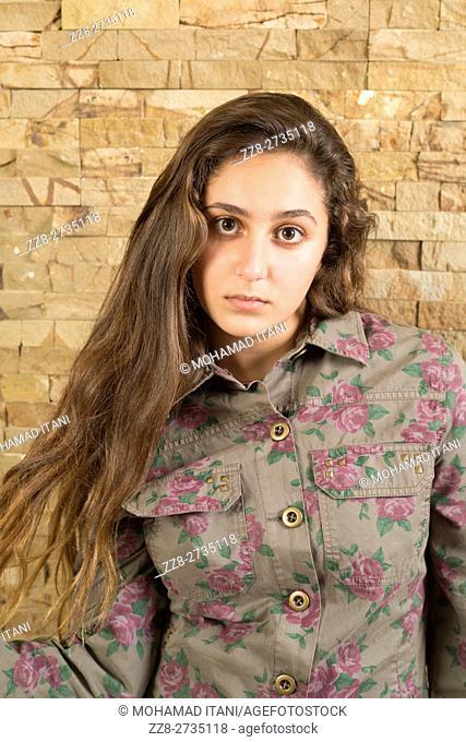 Serious teenage girl wearing floral jacket