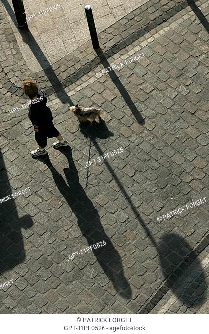 WOMAN WALKING HER DOG, CITY OF TOULOUSE, HAUTE-GARONNE 31, FRANCE