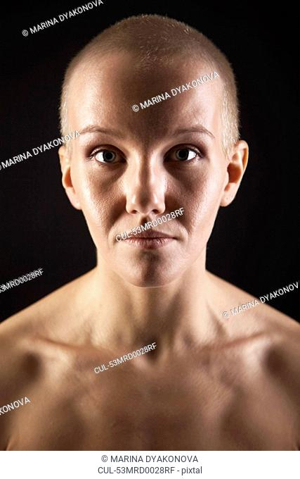 Nude woman with shaved head