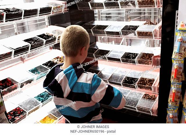 A boy choosing candy