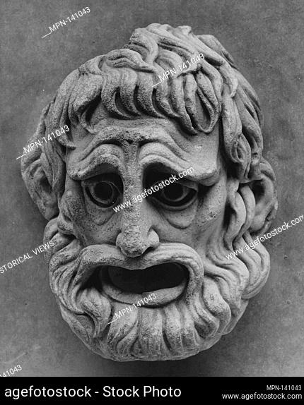 Mask. Date: modern?; Culture: Roman ?; Medium: Marble; Dimensions: Other: 13 3/8 x 9 5/16 in. (34 x 23.7 cm); Classification: Stone Sculpture; Credit Line:...
