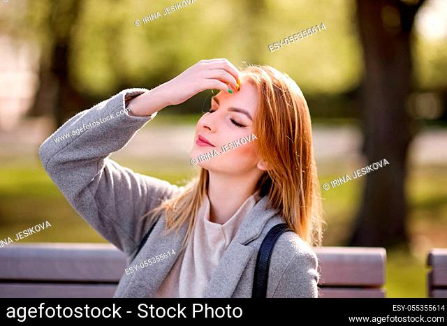 Summer sunny lifestyle trendy portrait of young stylish hipster woman walking on the street wearing cute trendy outfit