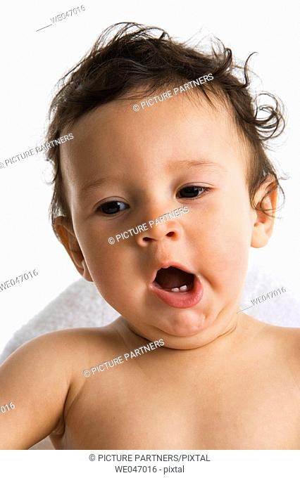 Portrait of a yawing toddler